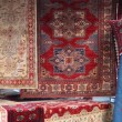 Street stall with resale of ancient Persian carpets - Stock Photo