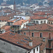 Stock Photo: Red tile rooftops and houses in old Italitown