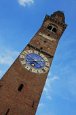 High tower with clock in red brick Basilica Palladiana in vicenz — Stock Photo