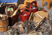 Bucket and other things for sale in the antique market — Stok fotoğraf