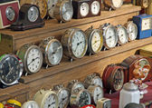 Antique vintage alarm clocks and watches for sale at flea market — Stock Photo