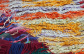 Wires and strings of a wool sweater for sale at the market — Stok fotoğraf
