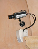 Video surveillance camera and a radar double intrusion detection — Stock Photo