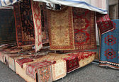 Street big stall with resale of ancient Persian carpets — Stock Photo