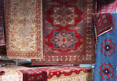 Street stall with resale of ancient Persian carpets — Stockfoto
