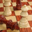 Royalty-Free Stock Photo: Checkmate with the King threw and the White Queen who wins