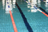 Olympic swimming pool with lanes bow before the race — Stock Photo