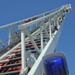Stair riser and blue truck Siren of firefighters during emerg — Stock Photo #22571403