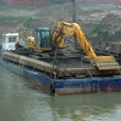 Stock Photo: Scraper on barge for cleaning of river bed of Rive
