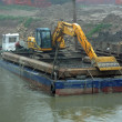 Scraper on a barge for the cleaning of the river bed of the Rive — Stock Photo #22571461