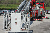 Fire truck with the stowed ready to get firefighters — Stock Photo