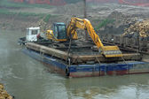 Scraper on a barge for the cleaning of the river bed of the Rive — Stock Photo