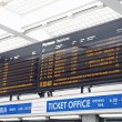 Board schedules of arrivals and departures of trains in an Itali — Stock Photo