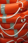 Piles of Orange life preserver for help to in danger of d — Stock Photo