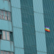 Peace flag hung a huge condominium skyscraper in Italian metropo — Stock Photo #22931330