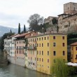 Houses of bassano city overlooking the brenta River on a cloudy - Stock Photo