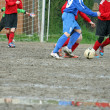 Children players during a football match - Stock Photo