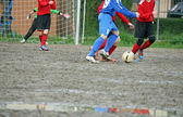 Children players during a football match — Stock Photo