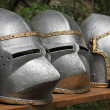 Постер, плакат: Medieval helmets of ancient a mighty iron armor used by the Knig
