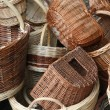 Stock Photo: Pile of Wicker baskets for sale at local flemarket