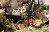 Cart and baskets with seasonal fruit and vegetables for sale at — Stock Photo