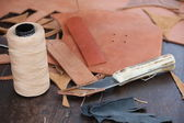 Roll of Twine and cutter for the craftsmanship of leather to pro — Stock Photo