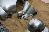 Gloves and metal armor with a helmet during the medieval spectac — Stock Photo