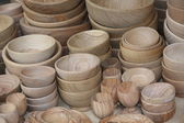 Crude wooden bowls for sale at the local flea market — Stock Photo