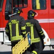 Stock Photo: Firefighters with stretcher up place of serious car ac