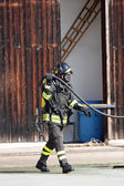 Brave firefighters with oxygen tank fire during an exercise held — Stock Photo