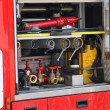 Stock Photo: Rescue equipment and shutting down fire inside fire truck