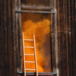 Fire in a House with thick orange smoke coming out from the — Stock Photo #25132371