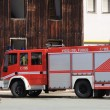 Fire truck parked after switching off of a fire — Stock Photo