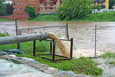 Impressive exhaust flows into river rainwater and mud — Stock Photo