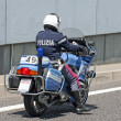 Stock Photo: Bikes with Italian police driver hurtling into the middle of the