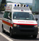 Italian Red Cross ambulance runs fast in the place of accident — Stock Photo