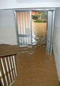 Entrance of a House fully flooded during the flooding of the riv — Stock Photo