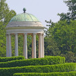 Stock Photo: Ancient Greek Roman-style Temple on Hill in Meadow Green