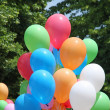 Foto Stock: Balloons during party for children and background leaves and g