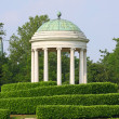 Ancient Greek Roman-style Temple on Hill in Meadow Green — Stock Photo #26558929
