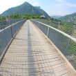 Long bridge with a wooden walkway and handrail made of galvanize — Stock Photo