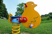 Joust with strong spring for little kids on the playground in th — Stock Photo