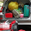 Car full of luggage bags and travel bags — Stock Photo