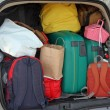 Stock Photo: Car full of suitcases and bags to return from holidays
