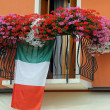 Stock Photo: Flowering balcony with Geraniums and the Italian flag