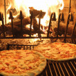 Excellent fragrant pizza baked in a wood fireplace 1 — Stockfoto