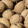 Stock Photo: Background of many mature Brown coconuts for sale at the market