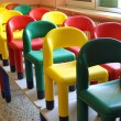 Chairs on the tables of the refectory of asylum during the clean — Stock Photo