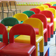 Little chairs on the tables of the refectory of asylum 7 — Stock Photo