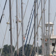 Poles and masts masters of luxury yachts and motor boats moored — Stock Photo